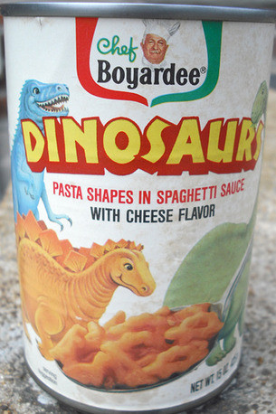 A can of Chef Boyardee's Dinosaurs are covered in cheese