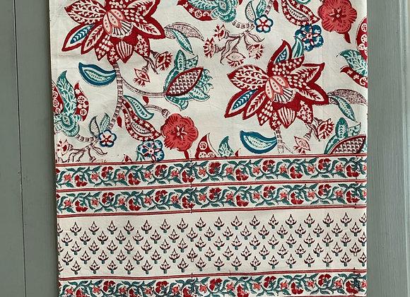 RED, BLUE AND LILAC DANCE ON CREAM TABLECLOTH