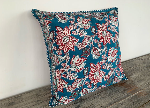 RED, BLUE AND LILAC DANCE ON CREAM CUSHION COVERS