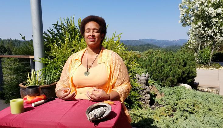 Sonya Meditating outside
