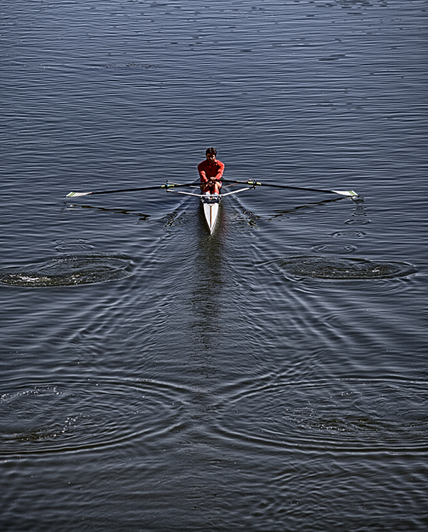 Rower under the bridge