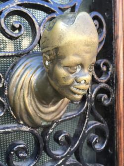 Decorative gate handle.