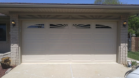 C.H.I. garage door with sunburst windows