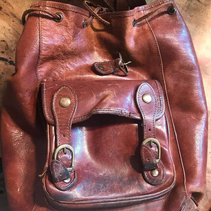 Hand stitching on a leather bag that the