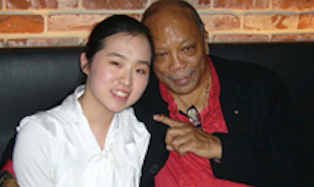 SJA alumna Chaeree Kaang with the legendary producer Quincy Jones