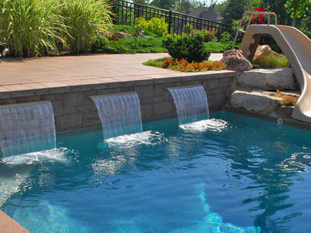 Why you should add a waterfall to your swimming pool
