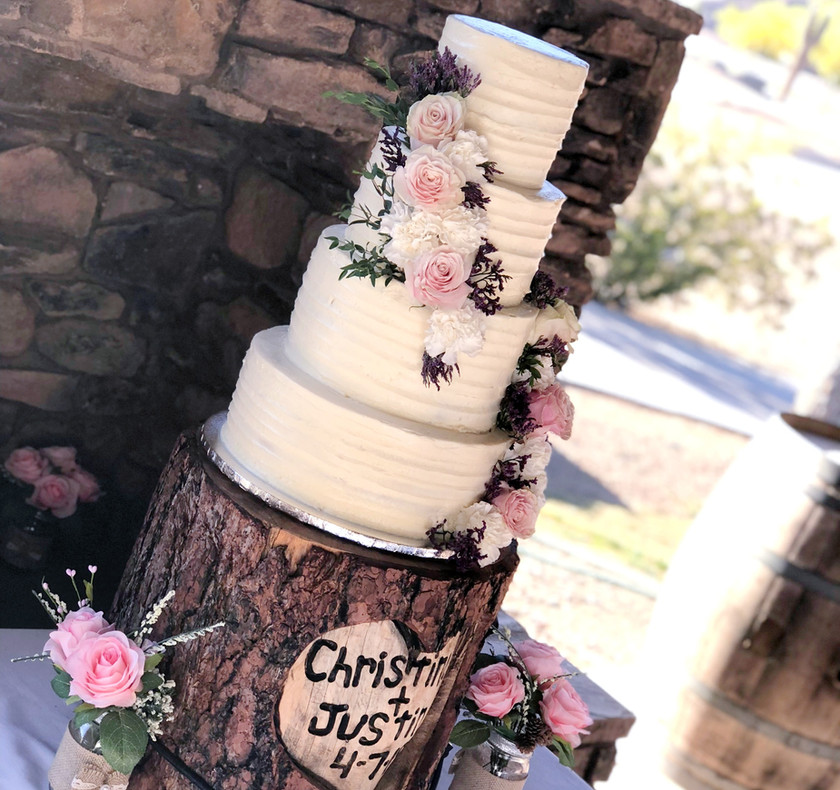 Four tiered outdoor wedding