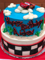Cars theme 2nd Birthday cake!  Both tiers are vanilla cake, one filled with cookies & cream and the other with strawberry compote.jpg