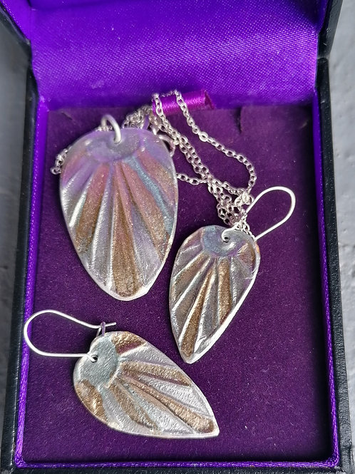 Solid silver earings and pendant set made. By Anita similar to those modled.