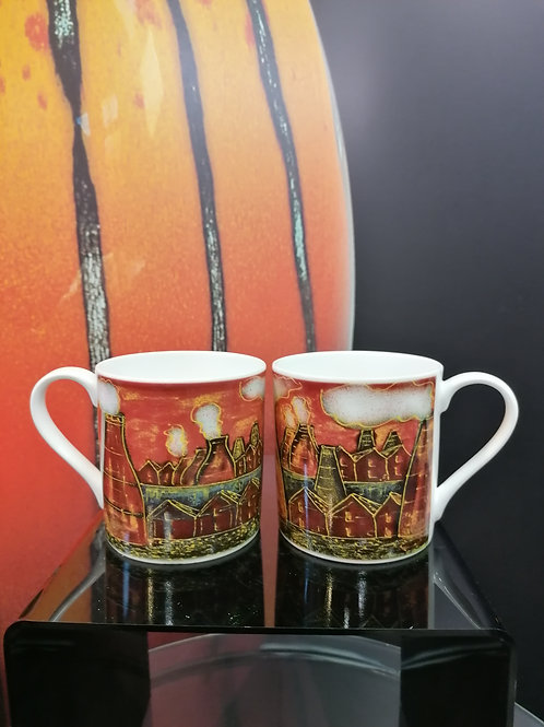 In stock pair of Potteries mugs