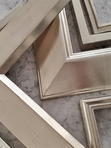 A fine selection of hand-finish 12kt white gold frames.