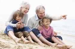 Grandparents And Grandchildren Sitting O
