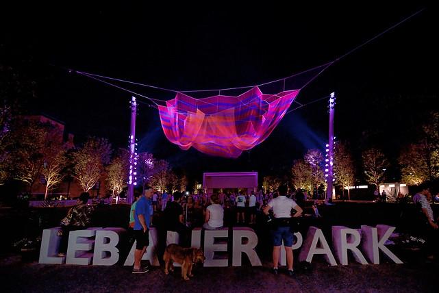 pink net floats over LeBauer Park Sign