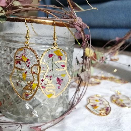 Floral face earrings
