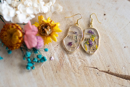 Floral face earrings