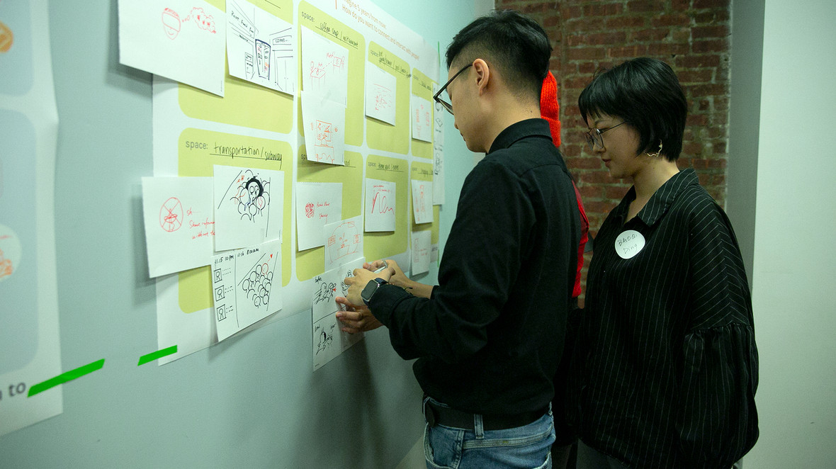 Participants putting up their ideas on the future scenario board.