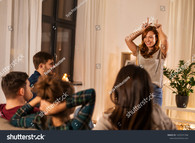 stock-photo-friendship-leisure-and-entertainment-concept-happy-friends-playing-charades-game-at-home-in-1435591586.jpg