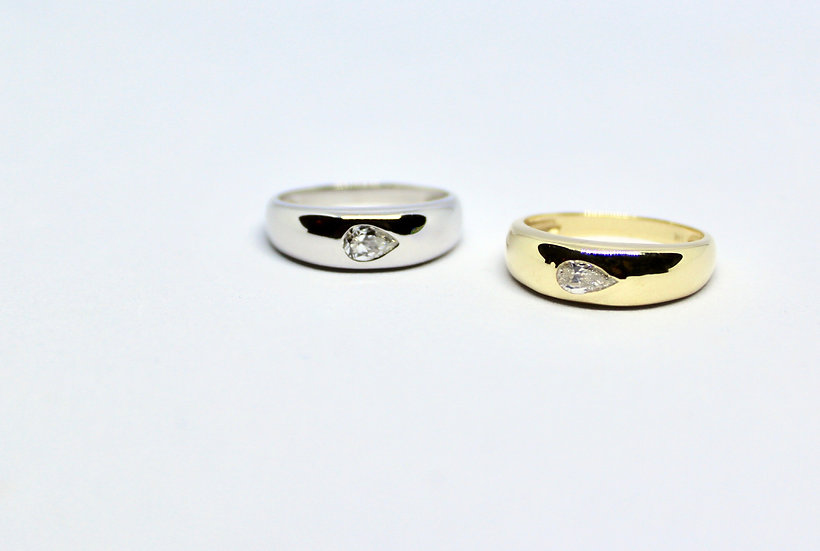 pear solitaire gypsy ring