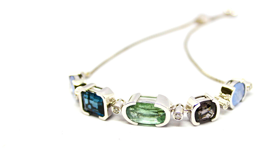 aquamarine, London Blue topaz, spinel and sapphire bracelet wrapped in solid white gold, barrett ford jewelry