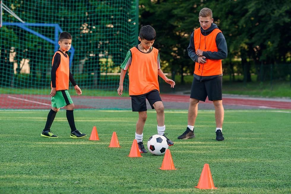 teen-boy-sportswear-trains-football-socc