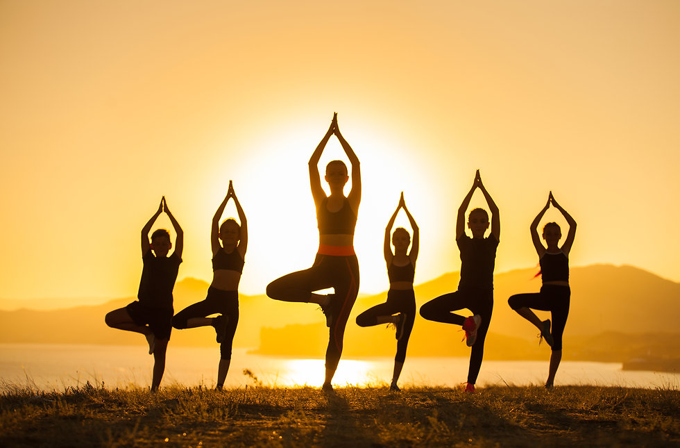 group-children-are-engaged-yoga-with-tra