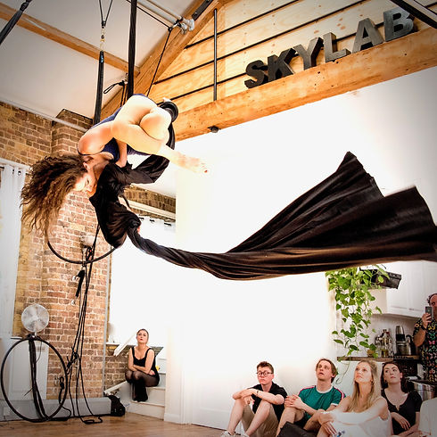 woman performing aerial silks