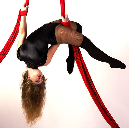 woman doing aerial silks