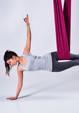 woman doing aerial fitness using a hammock