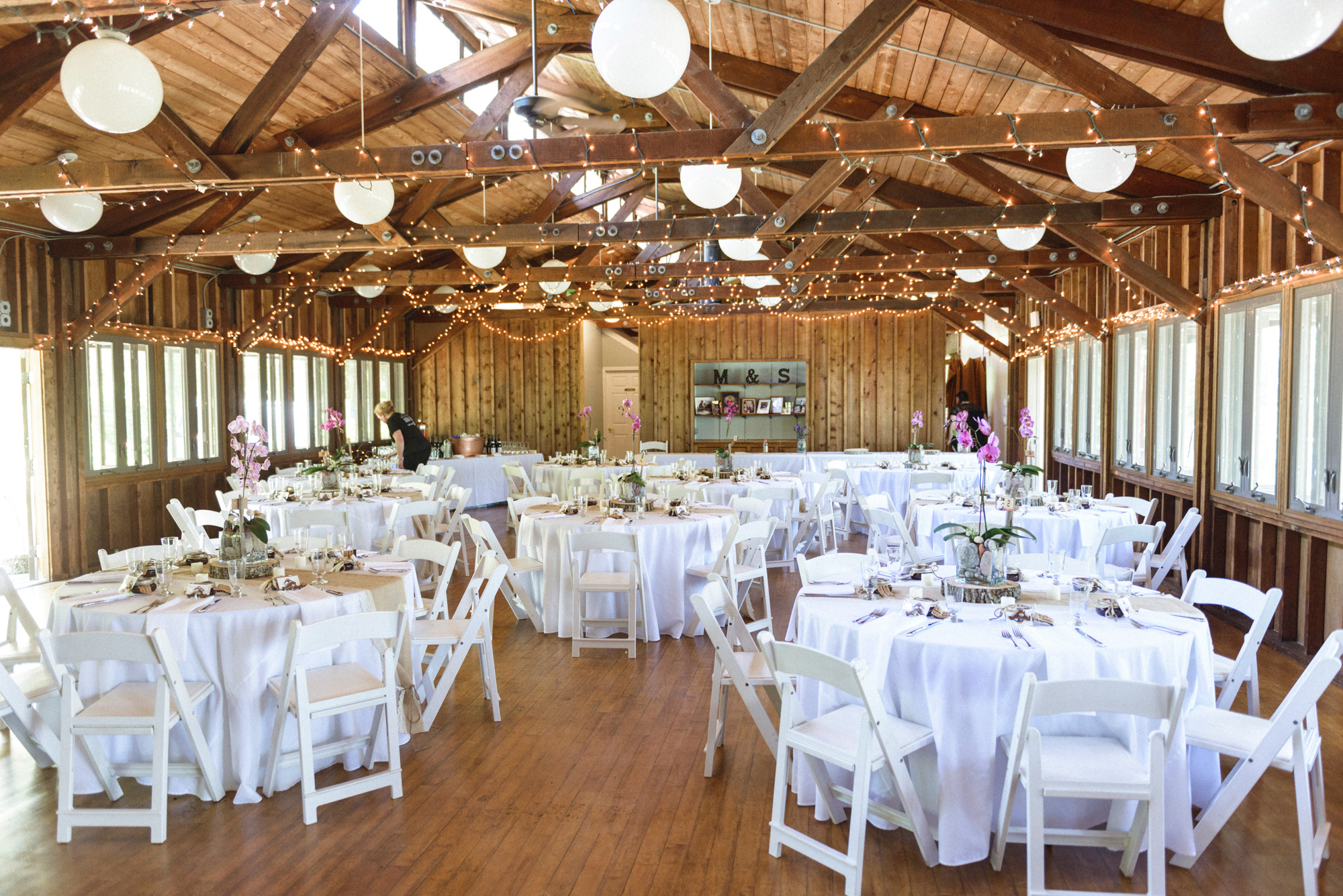 A wedding reception setup inside the mainstay at the Sailing Camp Park in Oak Bluffs martha's vineyard wedding venues photo by David Welch Photography