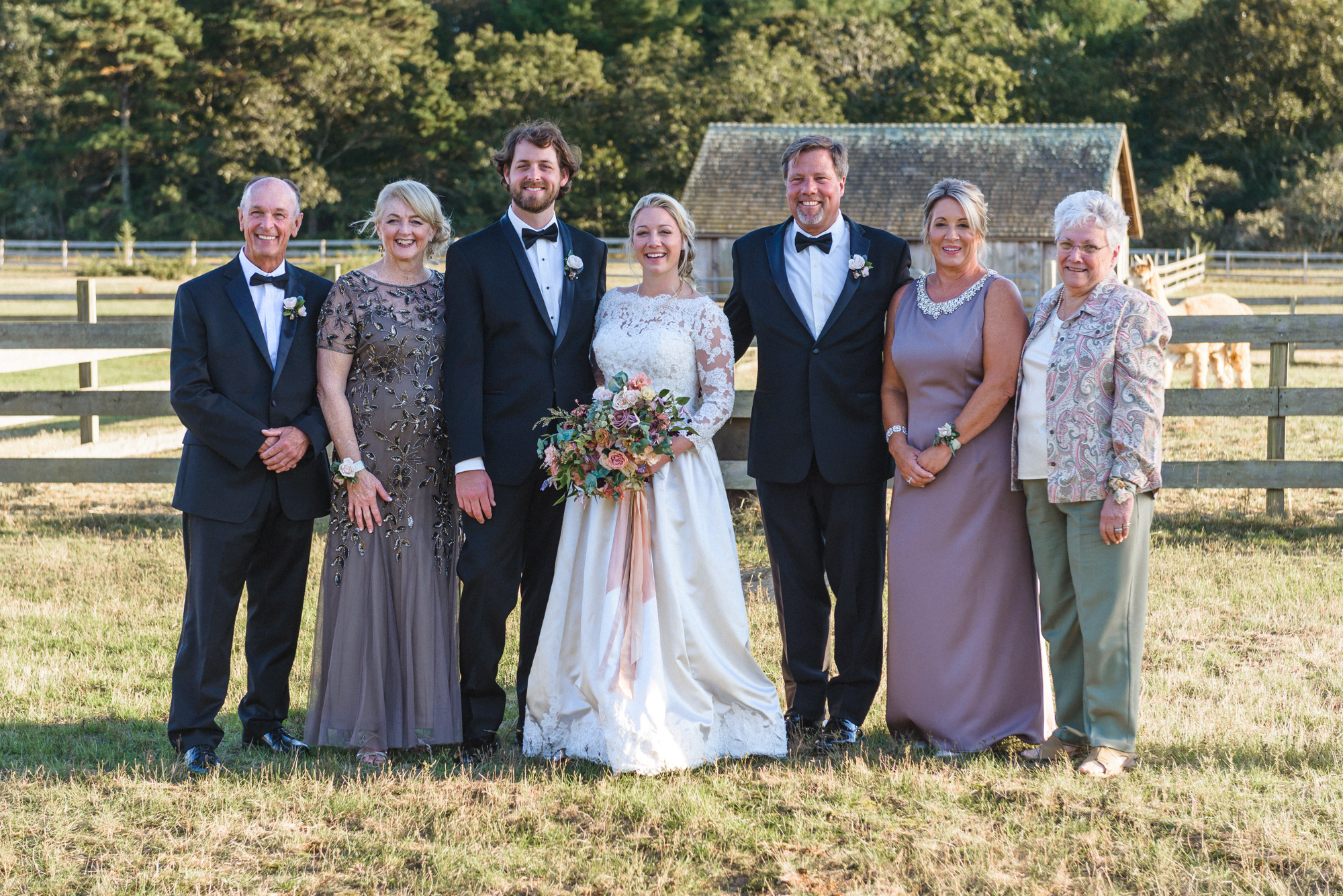 A formal family photo at Island Alpaca Company photo by David Welch Photography