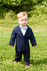 A little boy at a wedding ceremony photo by David Welch Photography