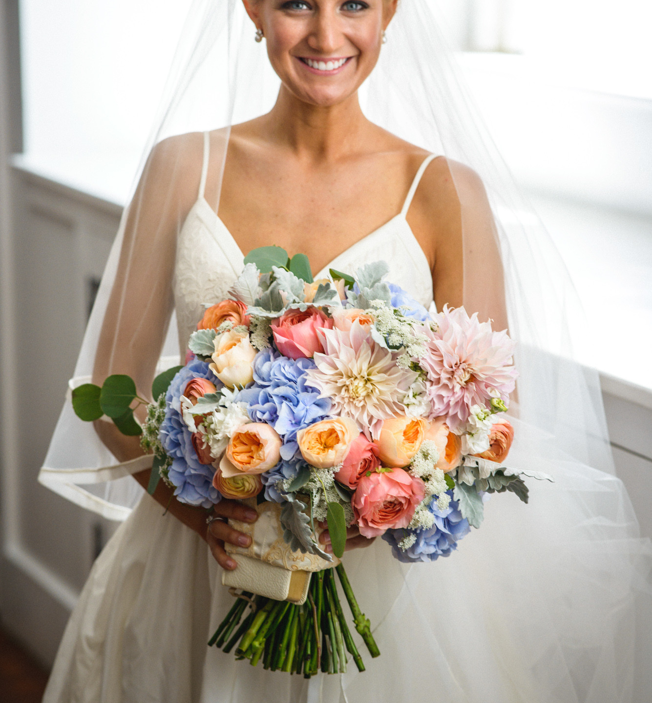 A bride and her bouquet inside the Old Whaling Church in Edgartown  photo by David Welch Photography