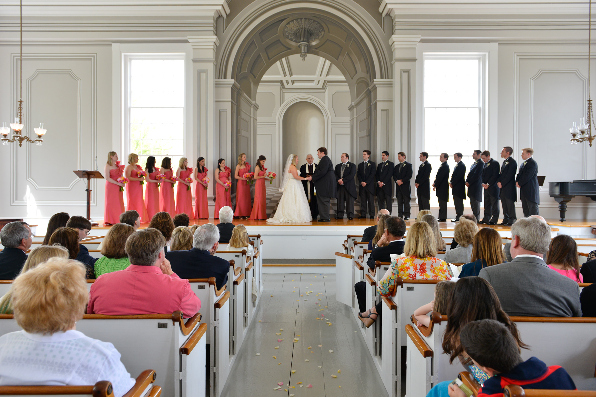 A wedding ceremony inside the Old Whaling Church in Edgartown  photo by David Welch Photography