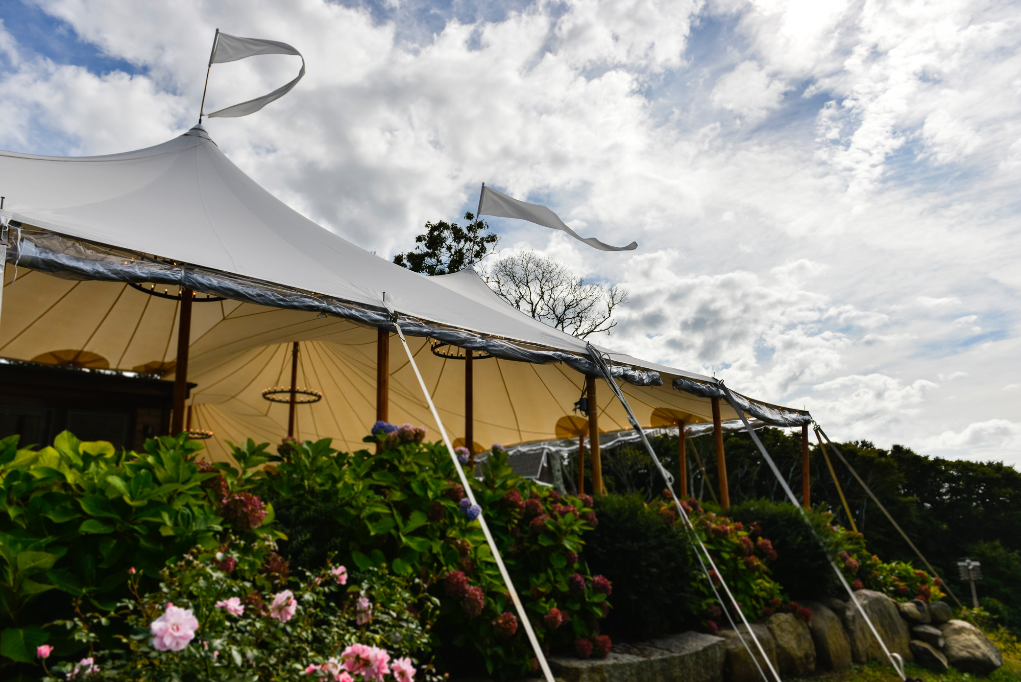 A reception tent against a glorious sky at The Beach Plum Inn & Restaurant photo by David Welch Photography