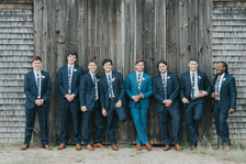 A wedding party poses for photos at a barn in West Tisbury photo by David Welch Photography