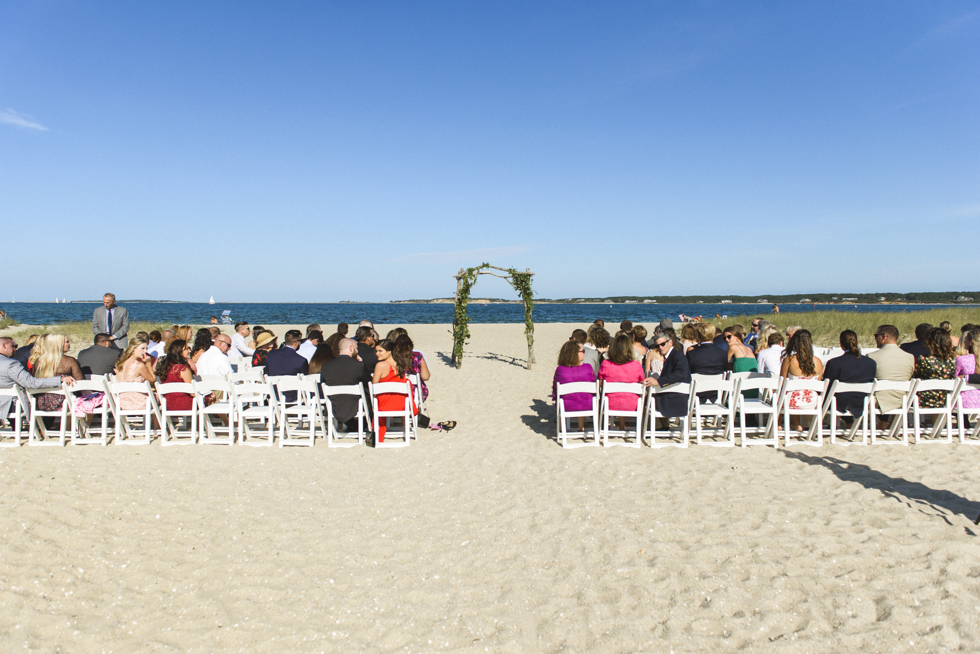 A wedding ceremony at Lighthouse Beach in Edgartown photo by David Welch Photography