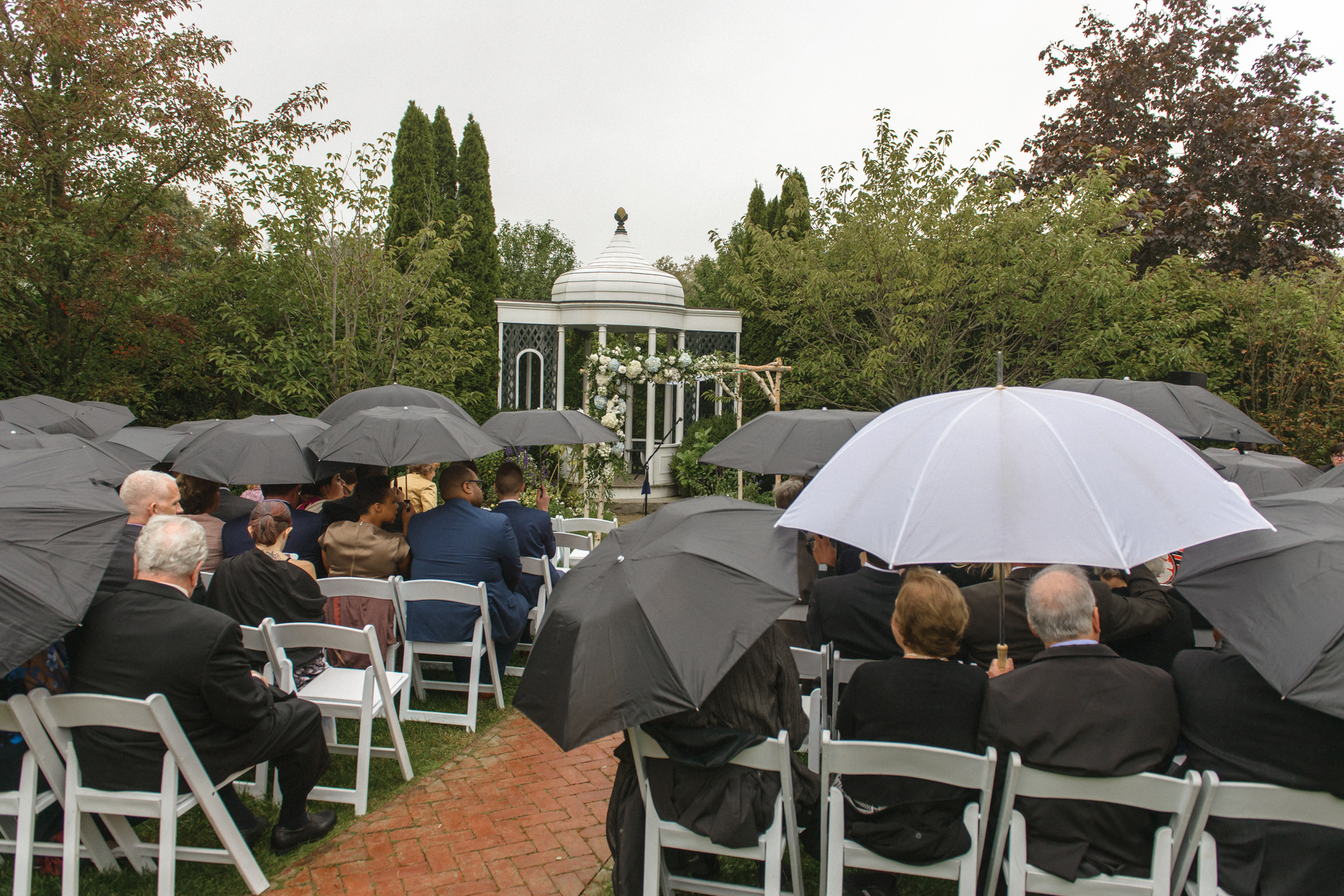 A bit of drizzle at this wedding ceremony at the Dr. Daniel Fisher House & Gardens photo by David Welch Photography