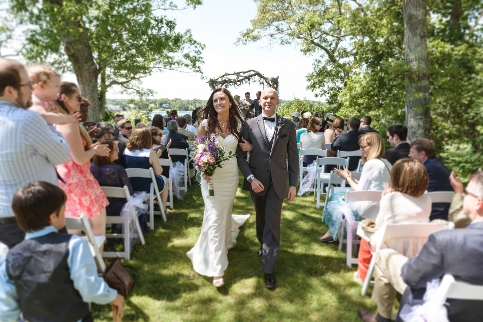 Newlyweds exit their wedding ceremony at the Sailing Camp Park in Oak Bluffs photo by David Welch Photography