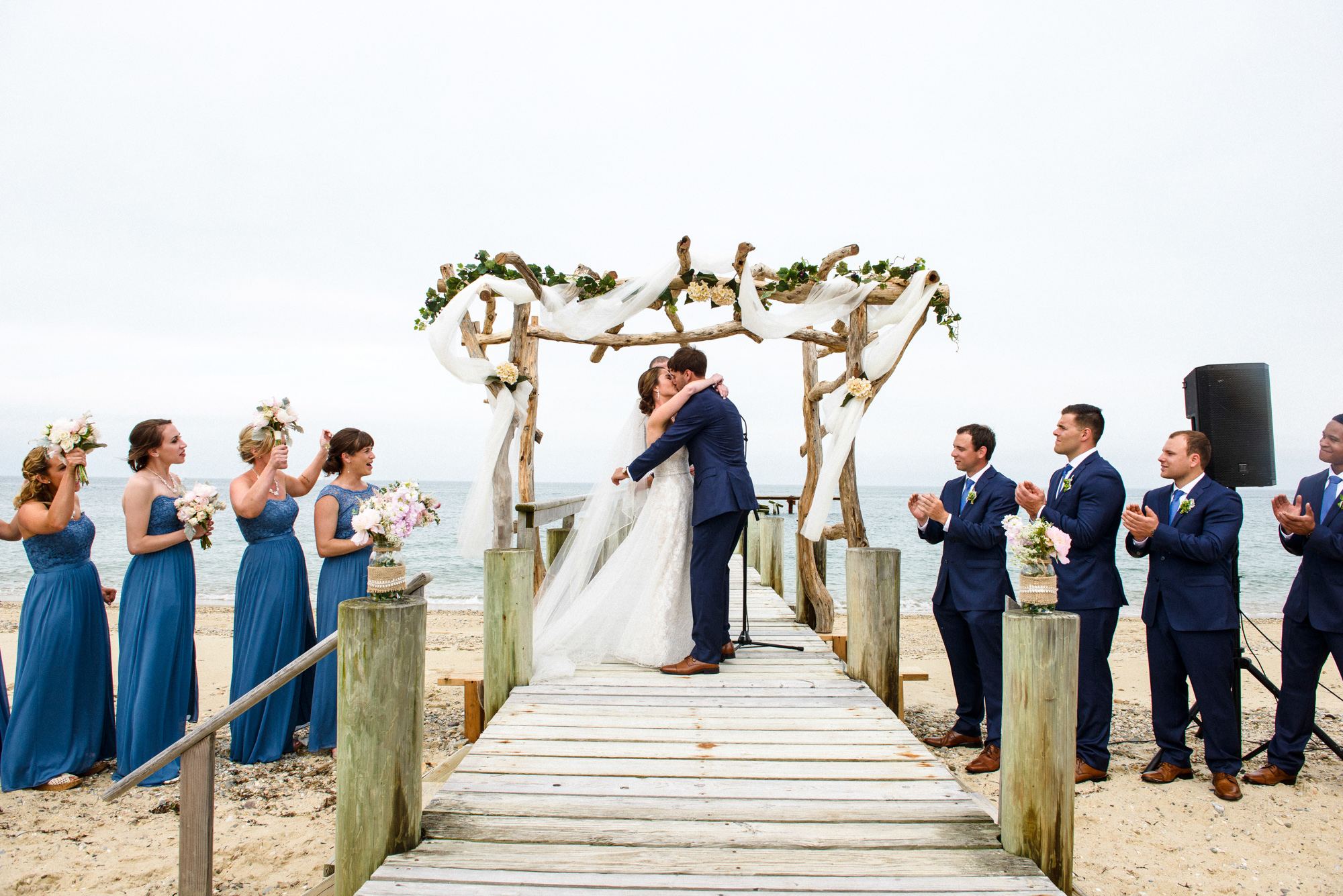 A wedding ceremony ends at the East Chop Beach Club in Oak Bluffs photo by David Welch Photography