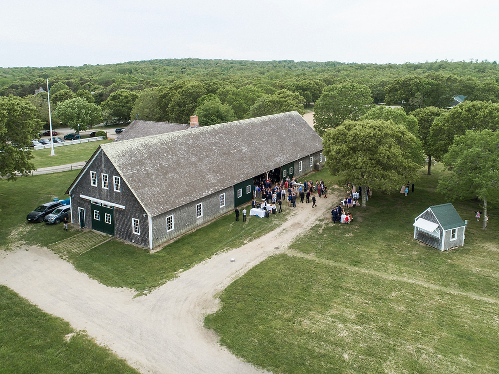 A drone photo of a wedding reception at the Martha's Vineyard Agricultural Society barn in West Tisbury photo by David Welch Photography
