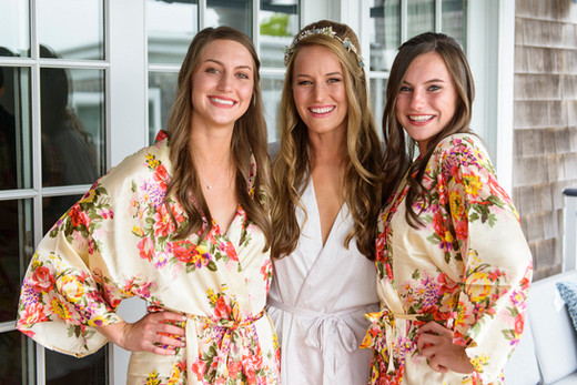 A bride and her sisters getting ready for the wedding ceremony photo by David Welch Photography