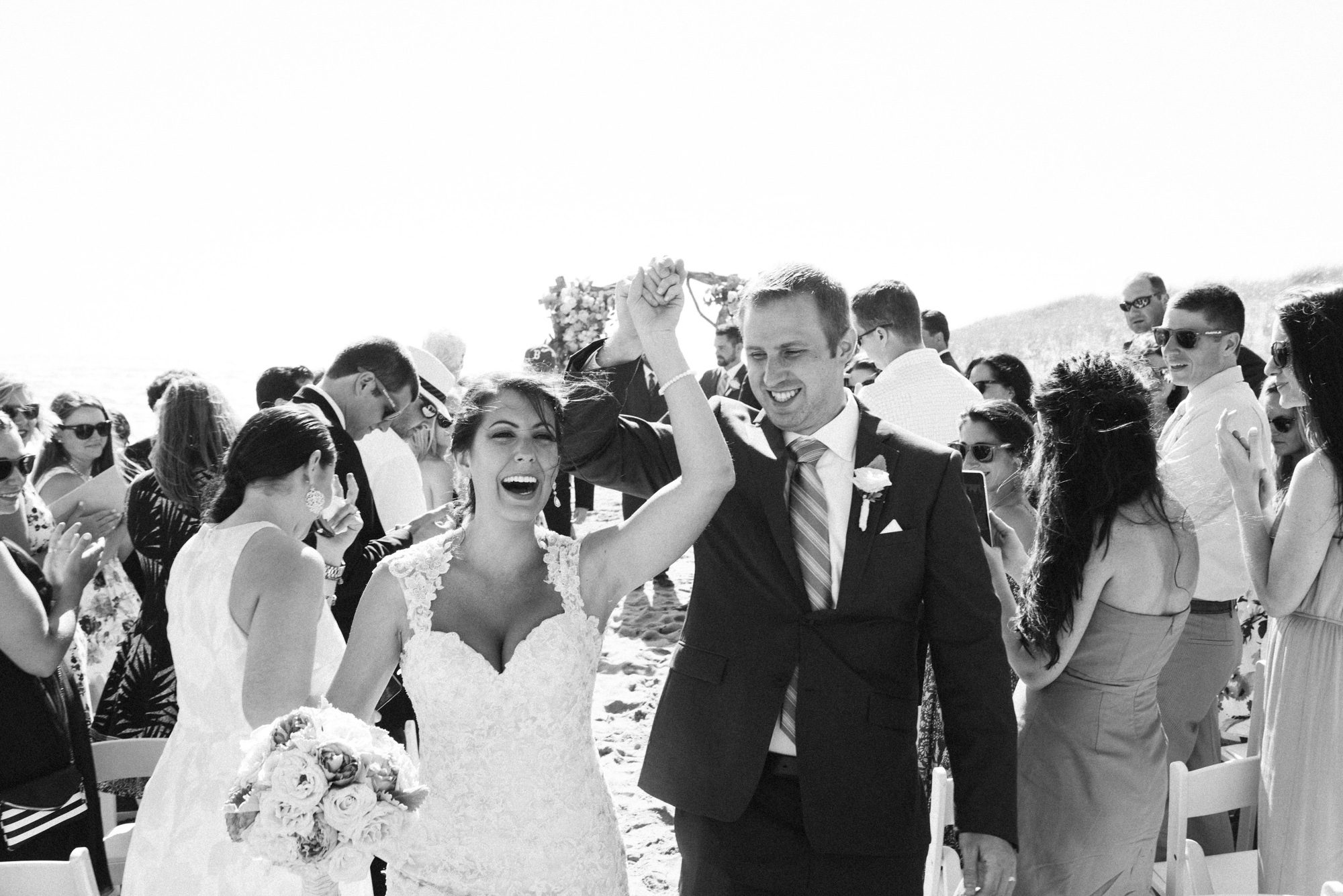 Cheers to the newlyweds at South Beach near the Winnetu Oceanside Resort in Edgartown  photo by David Welch Photography