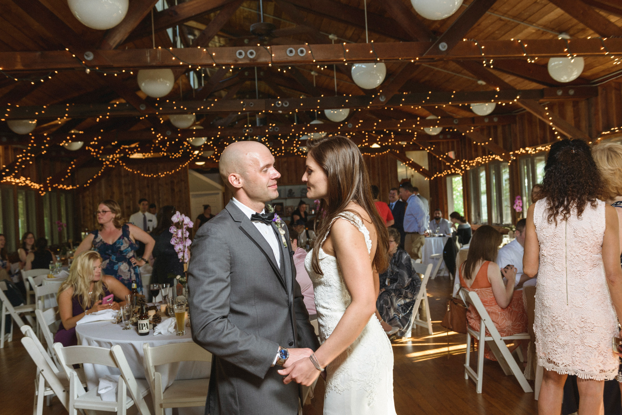 A bride and groom share their first dance at the Sailing Camp Park in Oak Bluffs photo by David Welch Photography