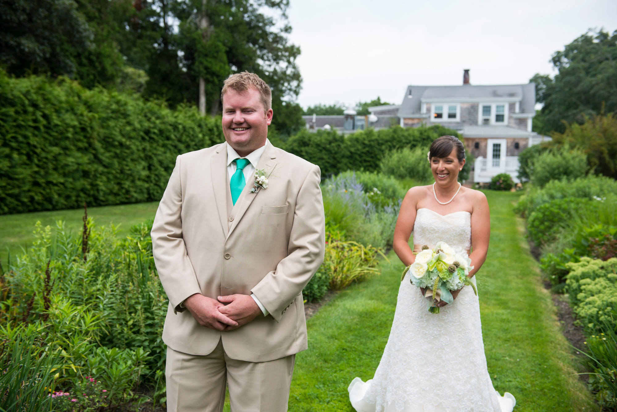 A bride and groom have their first look at Lambert's Cove Inn photo by David Welch Photography