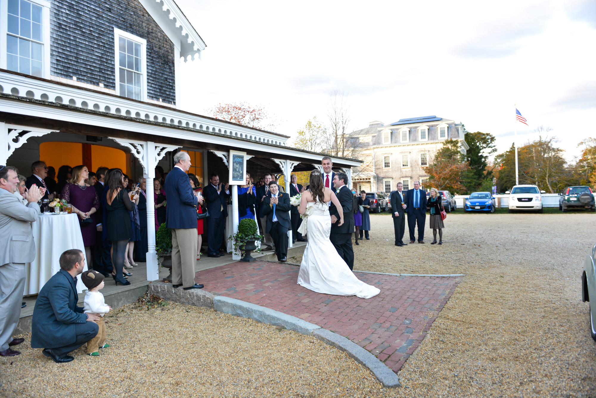 A bride and groom's grande entrance at the Grange Hall in West Tisbury photo by David Welch Photography