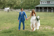 A bride and groom walking at a barn in West Tisbury photo by David Welch Photography