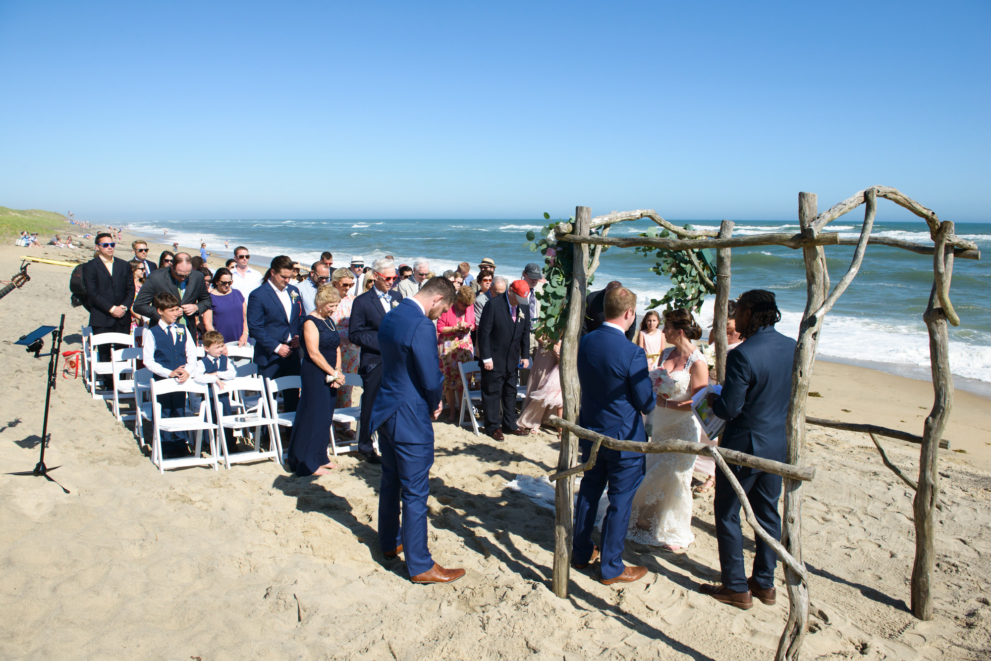 A South Beach wedding ceremony in Edgartown Massachusetts on the Island of Martha's Vineyard  photo by David Welch Photography