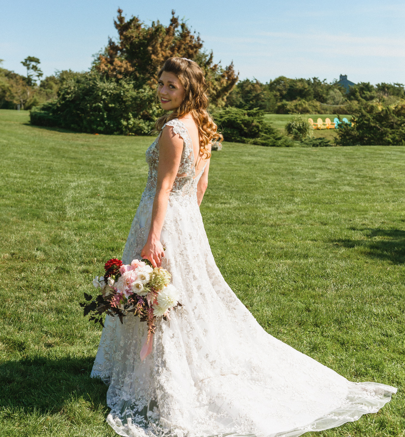 A bride on the lawn of the Winnetu Oceanside Resort in Edgartown  photo by David Welch Photography