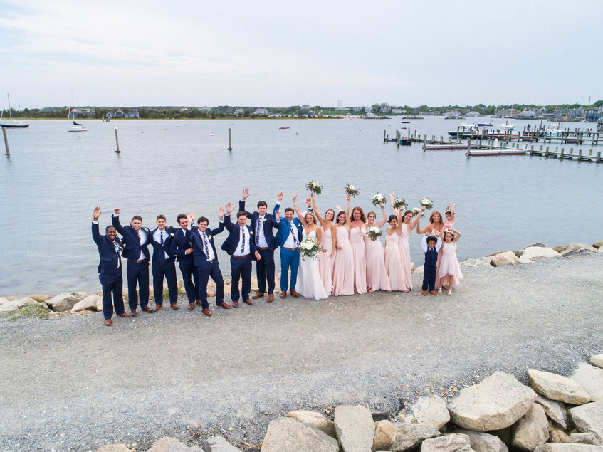 A drone photo of a wedding party near the Edgartown Lighthouse photo by David Welch Photography