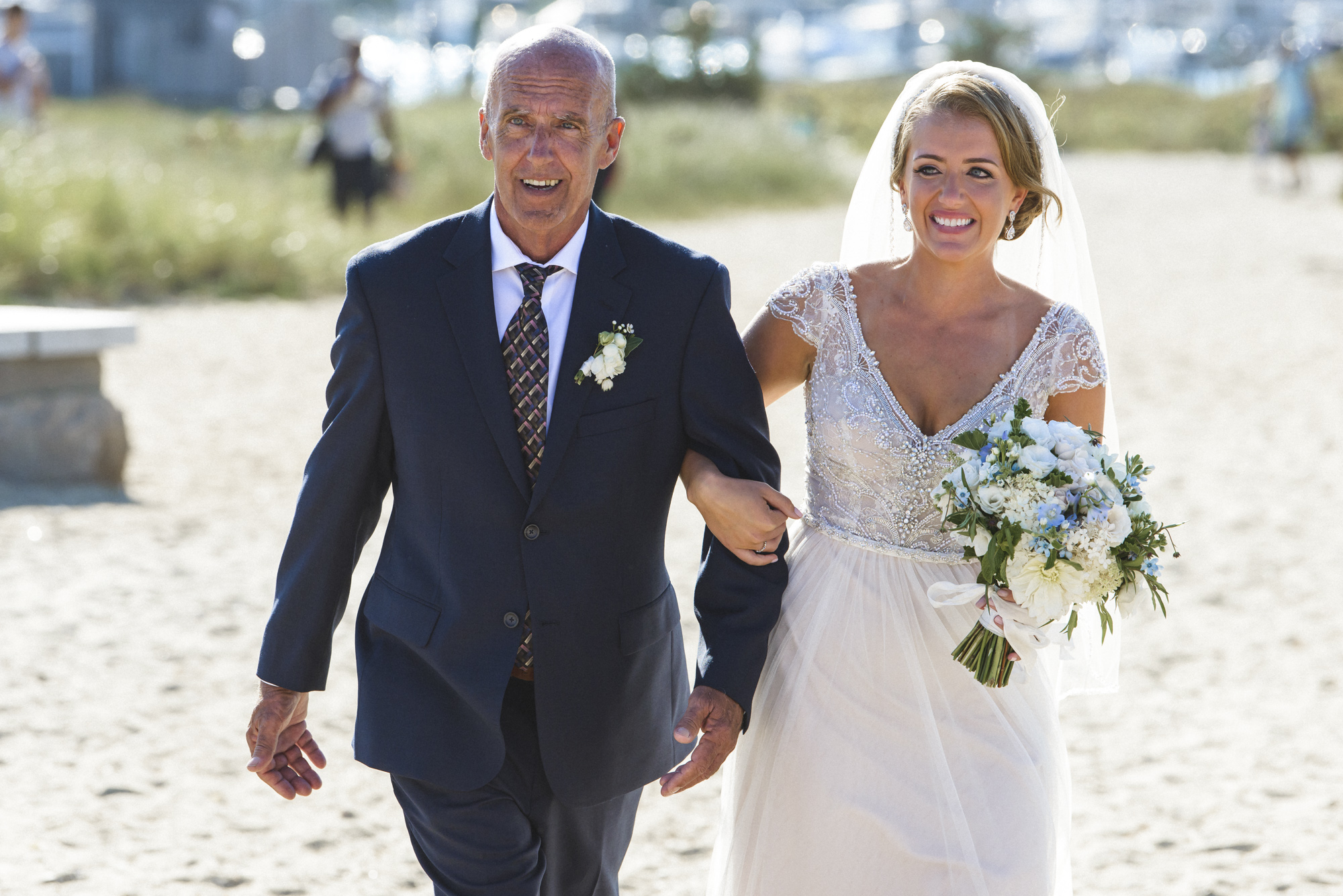 A father escorts his daughter to her wedding by the Edgartown Lighthouse on Martha's Vineyard photo by David Welch Photography